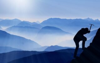creating a success mindset during Covid 19 isolation with man climbing a mountain