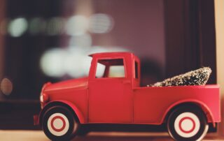 red vintage truck Christmas toy car gearing up for the holiday season
