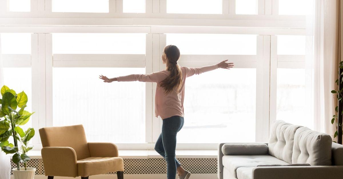 women enjoying her home that feels larger