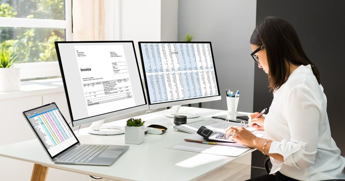 Accountant reviewing accounting documents for business client in Ontario, Canada
