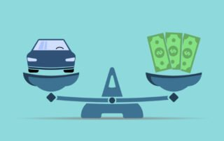 blue car on scale beside money signaling cheap car insurance options